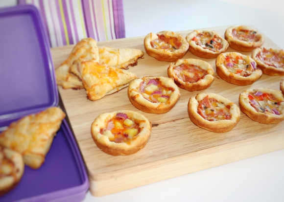 Pillsbury crescent dough Pizza Bites in a purple lunch box and spread on a wooden board Image by CeeGrrn